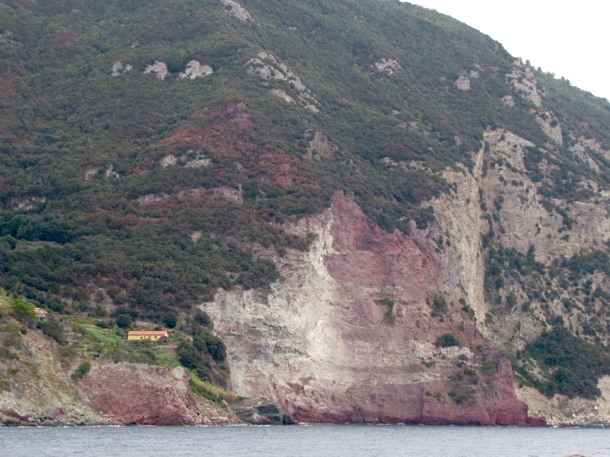 Coastal red cliffs as you approach Porto Venere