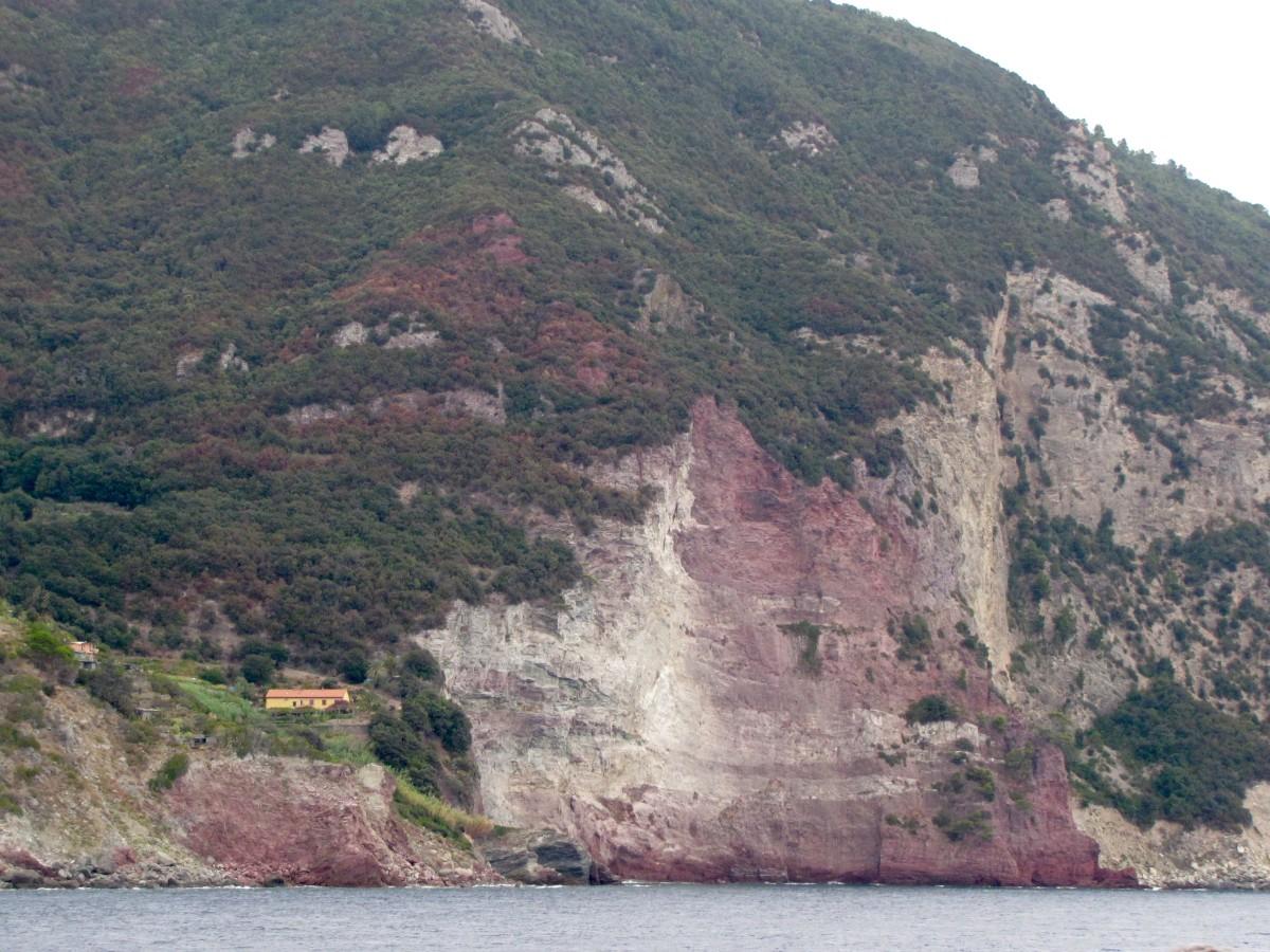 Coastal red cliffs as you approach Porto Venere.