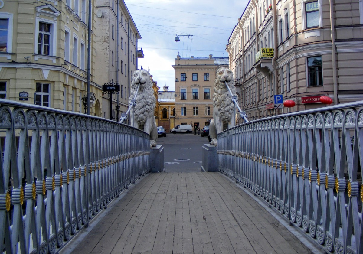 This charming pedestrian bridge (built in 1826) and the area surrounding it didn't change much since Dostoevsky's times. It is approximately halfway between Sonya Marmeladova's house and the old woman pawnbroker's house.