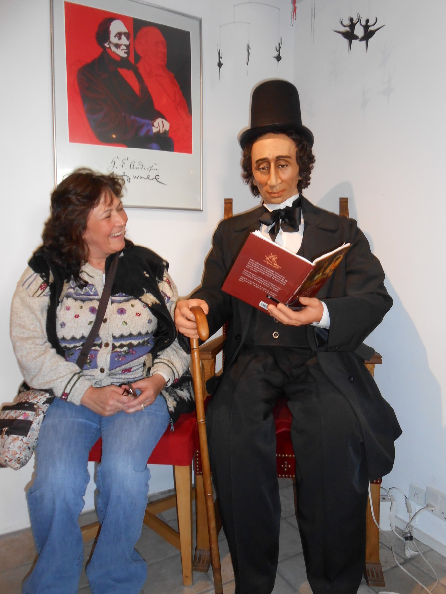 As you can see I am enjoying being read to by Hans Christian Andersen in the gift shop in Nyhavn!