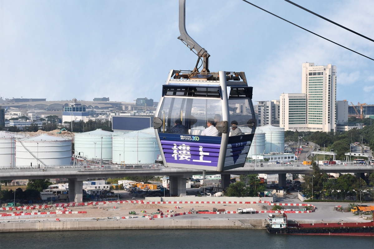 Sweeping views of Tung Chung and surrounding areas as cable cars cross over to the hills.
