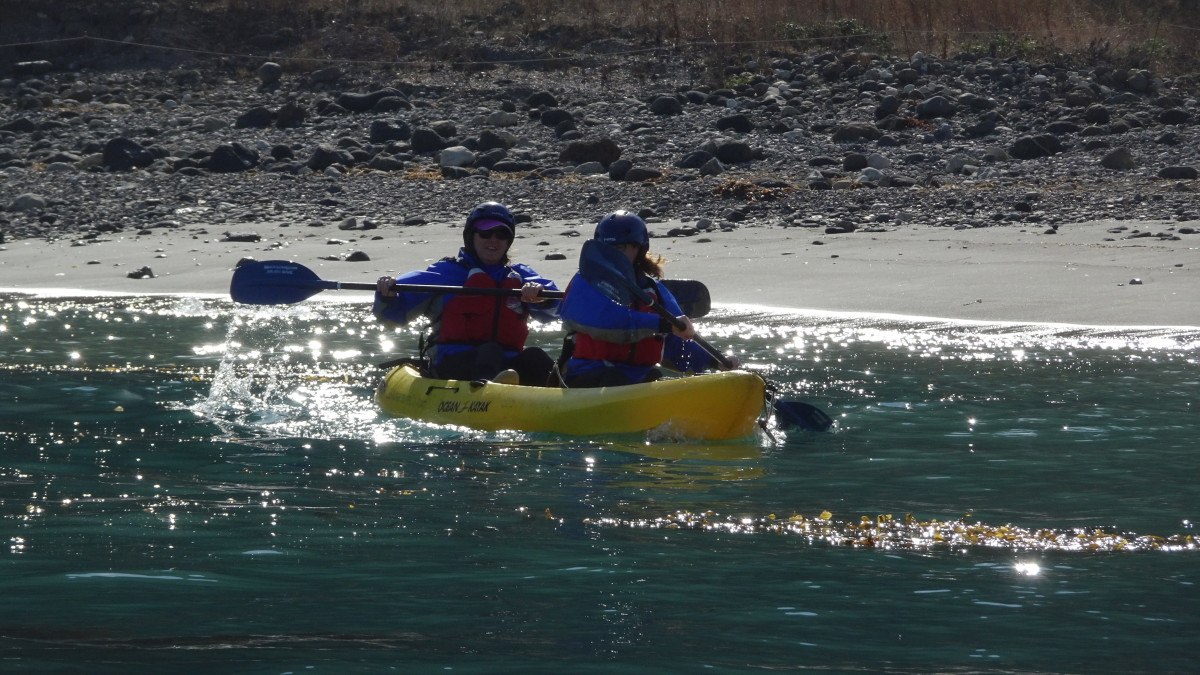 Launching Kayaks at Santa Cruz Island. Having a guide to stabilize the kayak during launch is extremely valuable.
