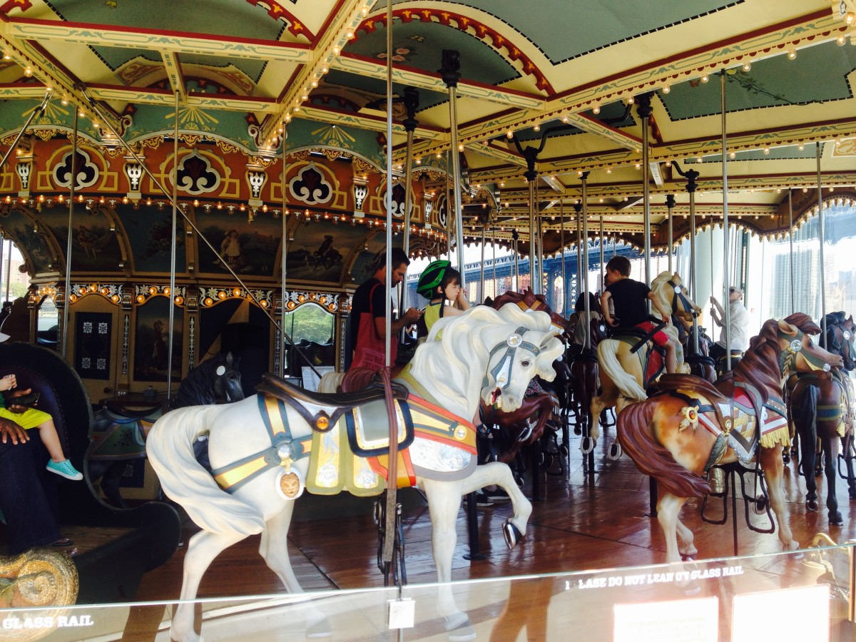 Toddlers and older kids love riding Jane's Carousel's horses in Brooklyn, New York City.