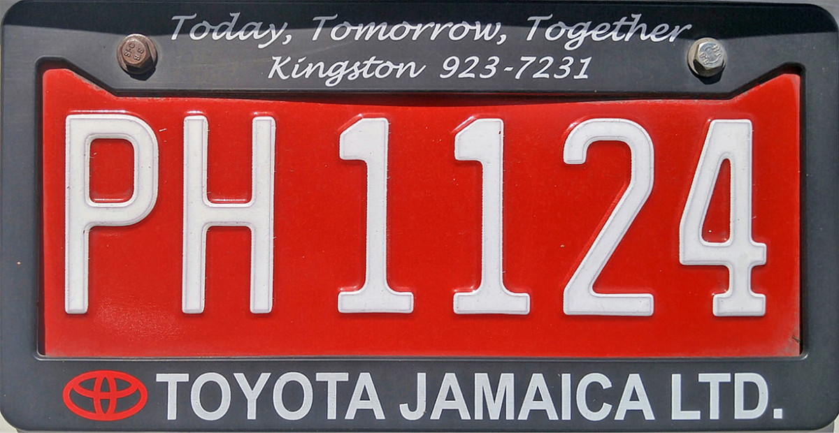 Red license plates for vetted drivers.  One of the many ways the government tries to limit crime in Jamaica.