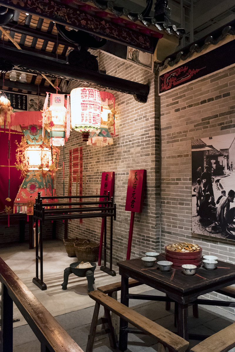 The interior of a traditional home. Displayed on the table is poon-choi, a popular dish traditionally eaten during Chinese New Year.