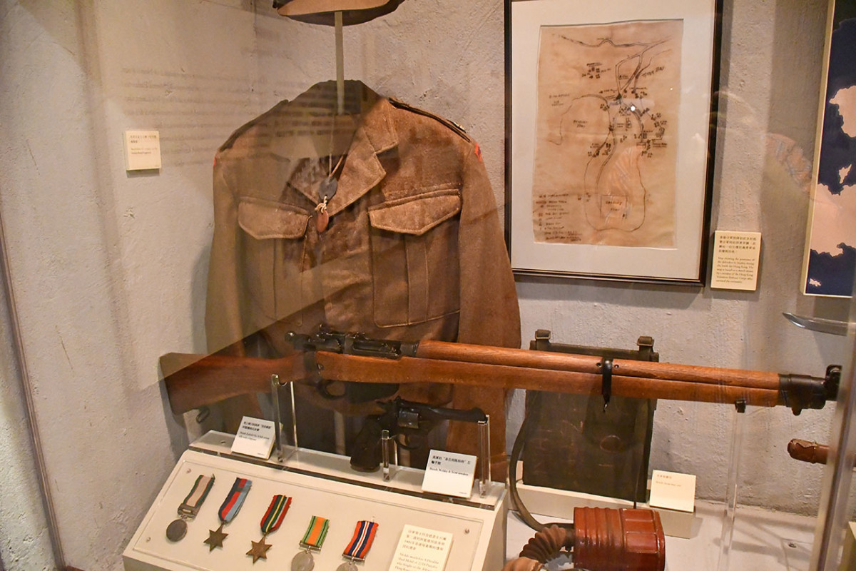 British military uniform and rifle during the Japanese invasion.