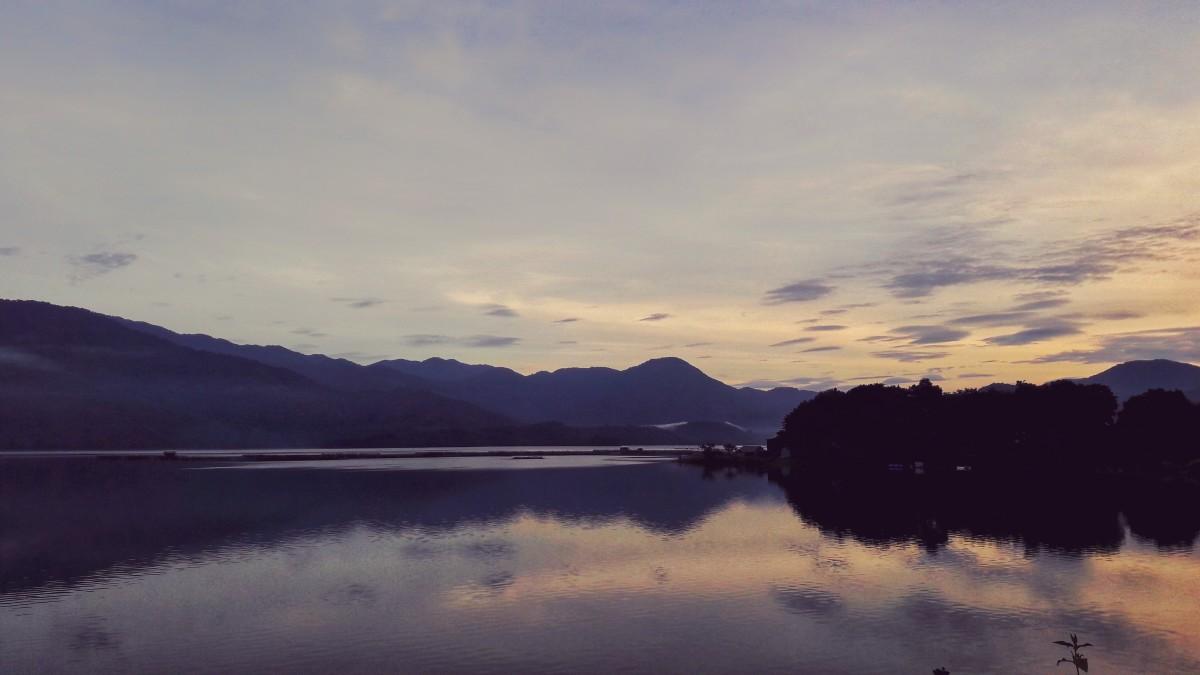 The horizon is blushing.
