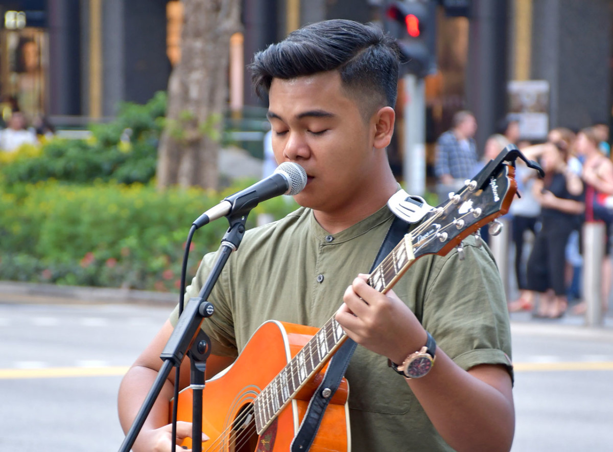 Singaporean busker along Orchard Road.