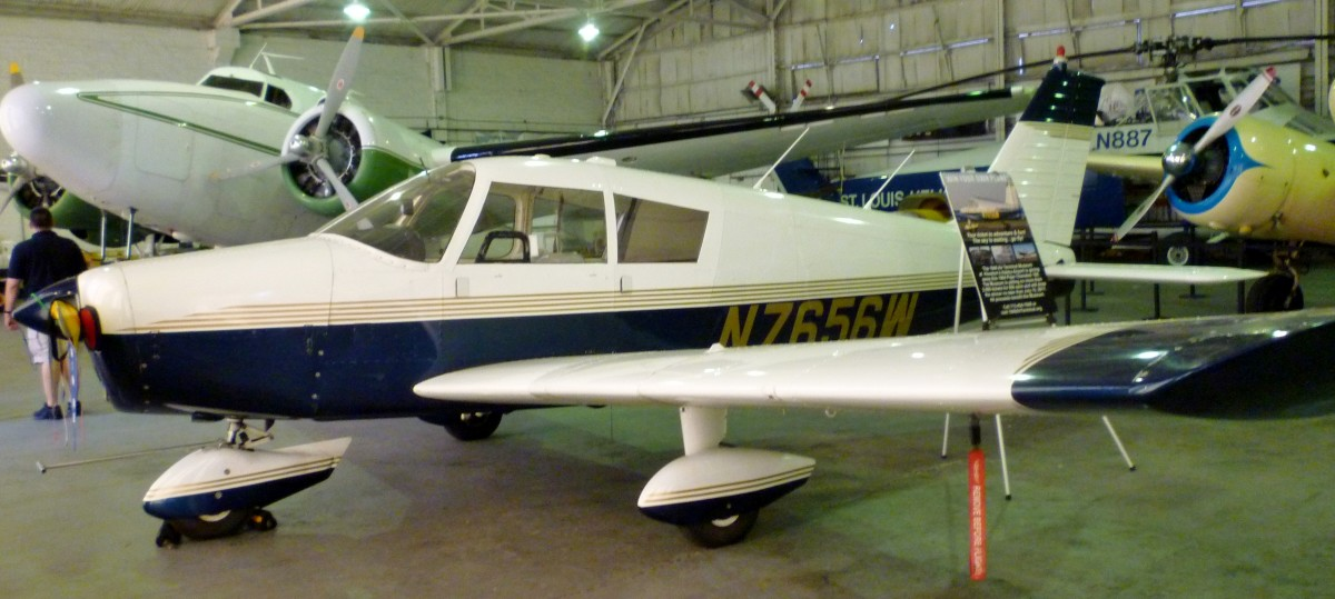 1964 Piper Cherokee 180 (foreground) being auctioned off at 1940 Air Terminal Museum Hangar