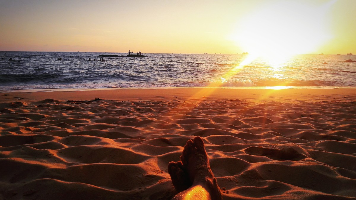 Or sit still on the beach to watch the sunset.