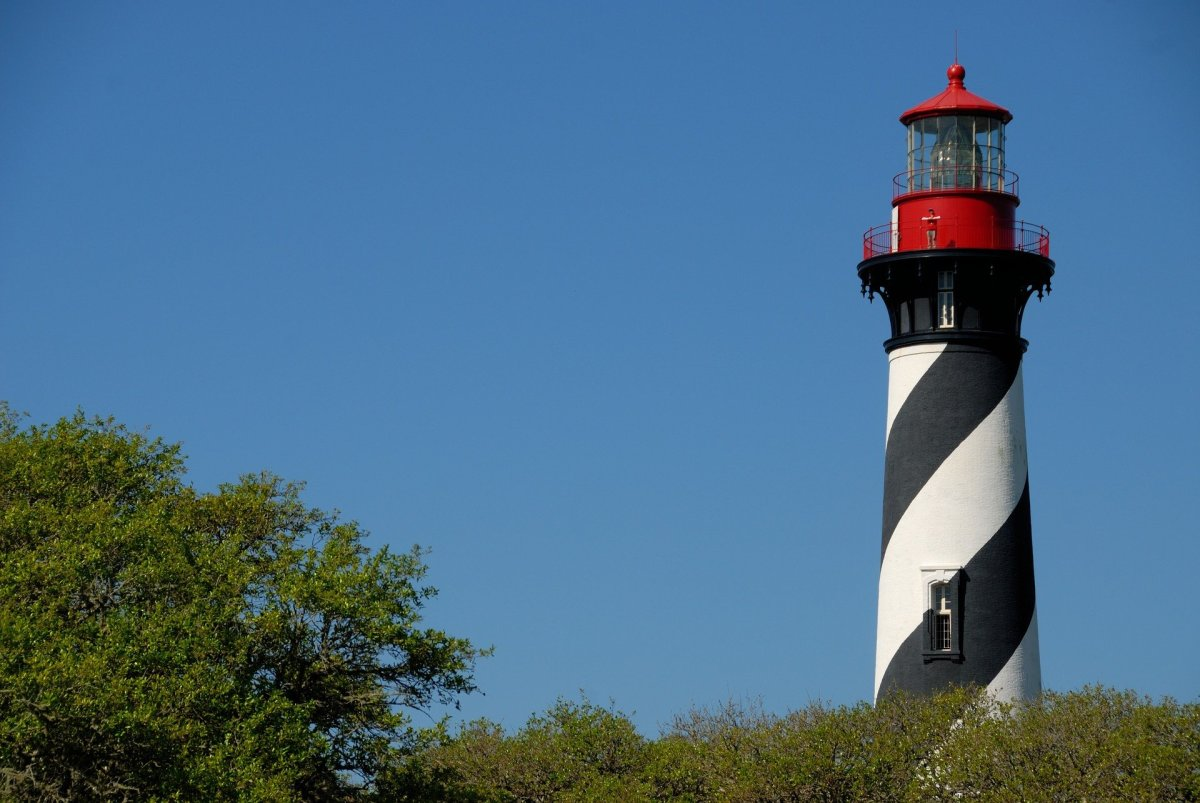 St. Augustine Lighthouse with its black and white spiral-striped tower.