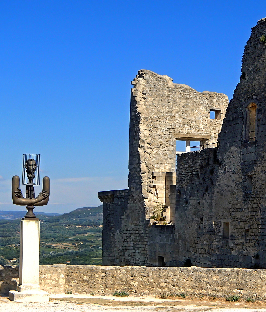 Modern sculpture of the Marquis de Sade stands guard outside his castle in Lacoste.