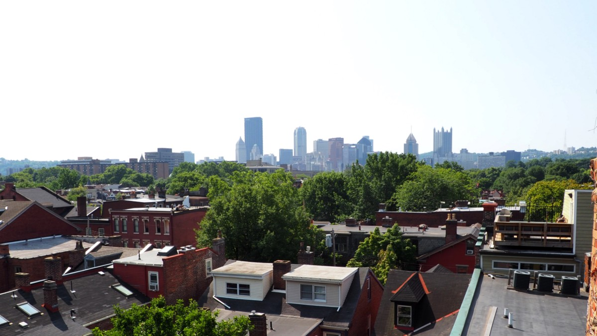 It can get hazy, hot and humid in the summer.  The view of downtown from the stairwell of a museum in the Mexican War Streets area of Pittsburgh, PA.