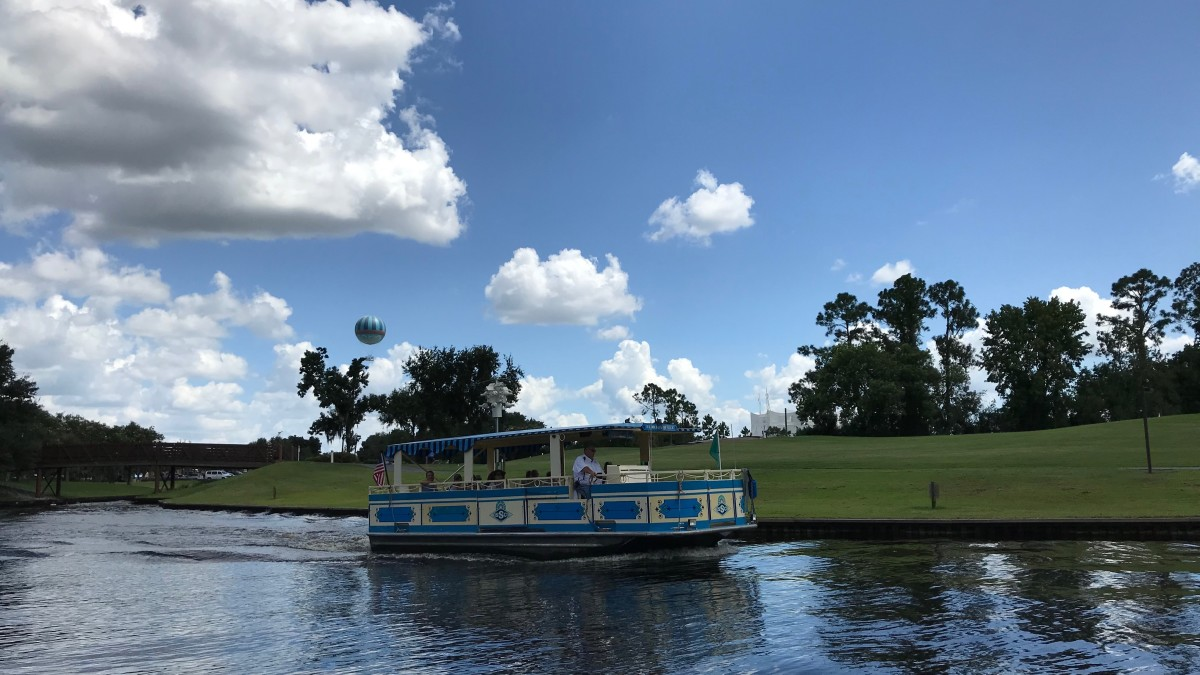 Relax while floating down the Sassagoula River to Disney Springs for shopping and dinner.