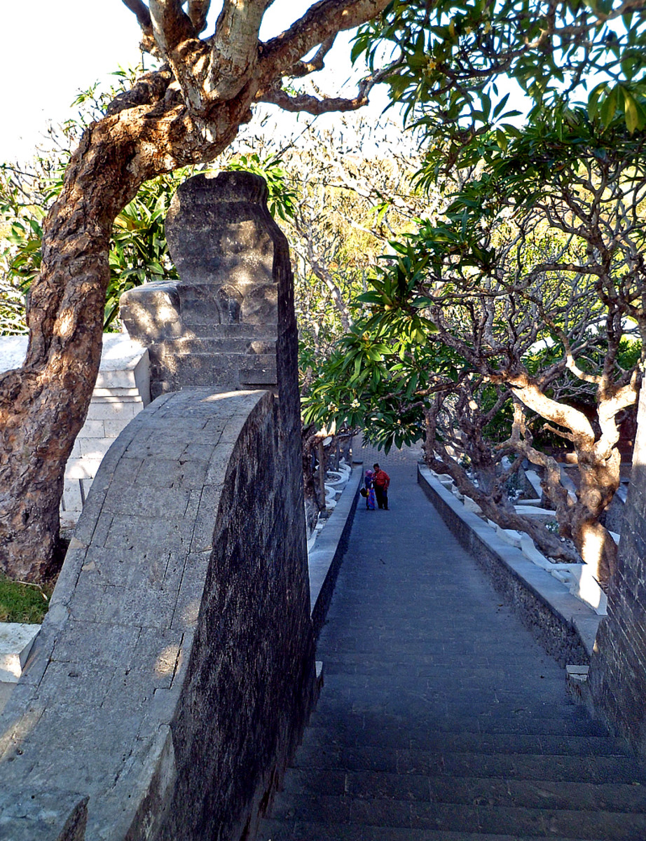 Climbing up the stairs at the temple's entrance.