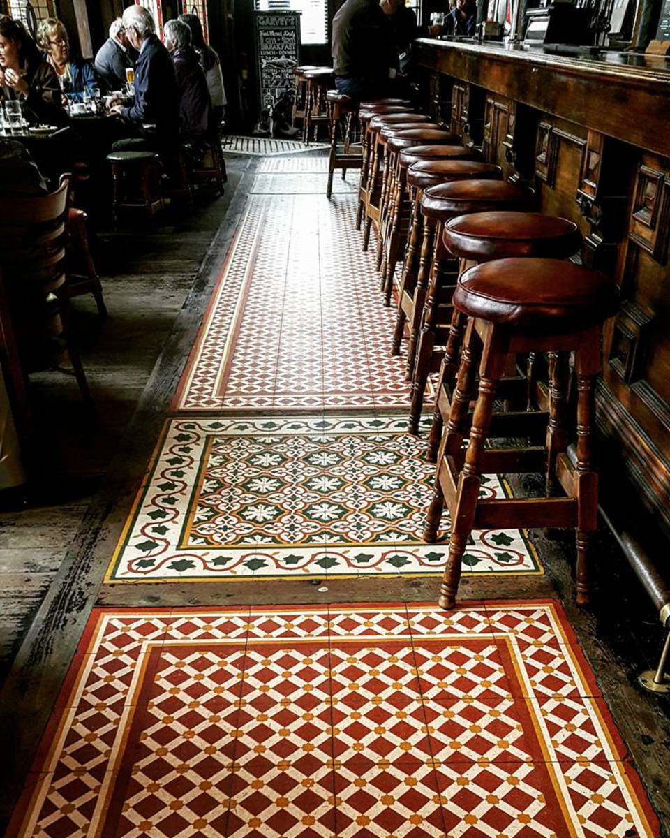 Exquisite tile work covers the floor of this pub.