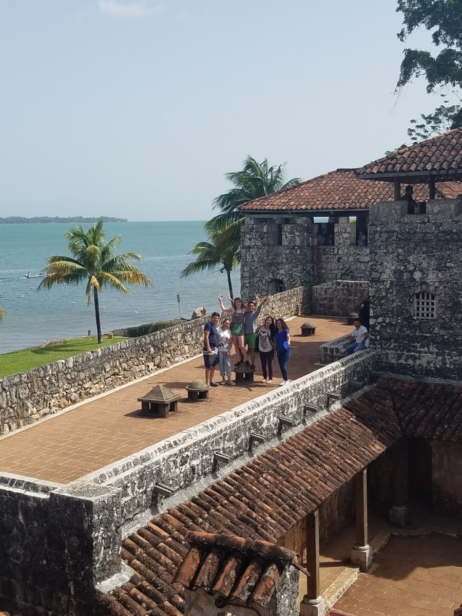 Exploring El Castillo de San Felipe with the amazing view of the water in the background.