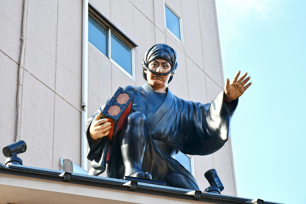 A watchful ninja atop a building in the historical Asakusa district of Tokyo.