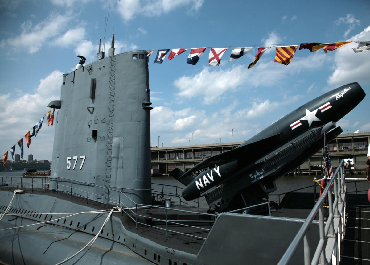 The USS Growler submarine docked next to the USS Intrepid.