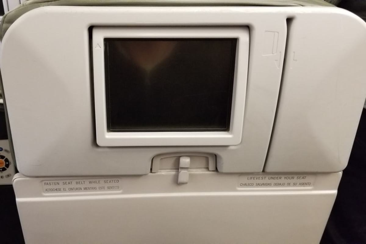 A very dated, low definition, and very small media screen was on the back of each seat (non-touchscreen).
