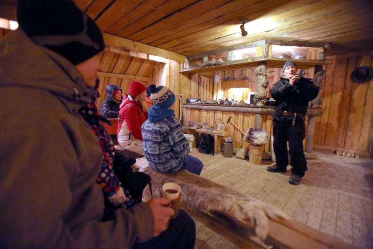 A guide explains the history and geology of this special area from within the mine's cabin.