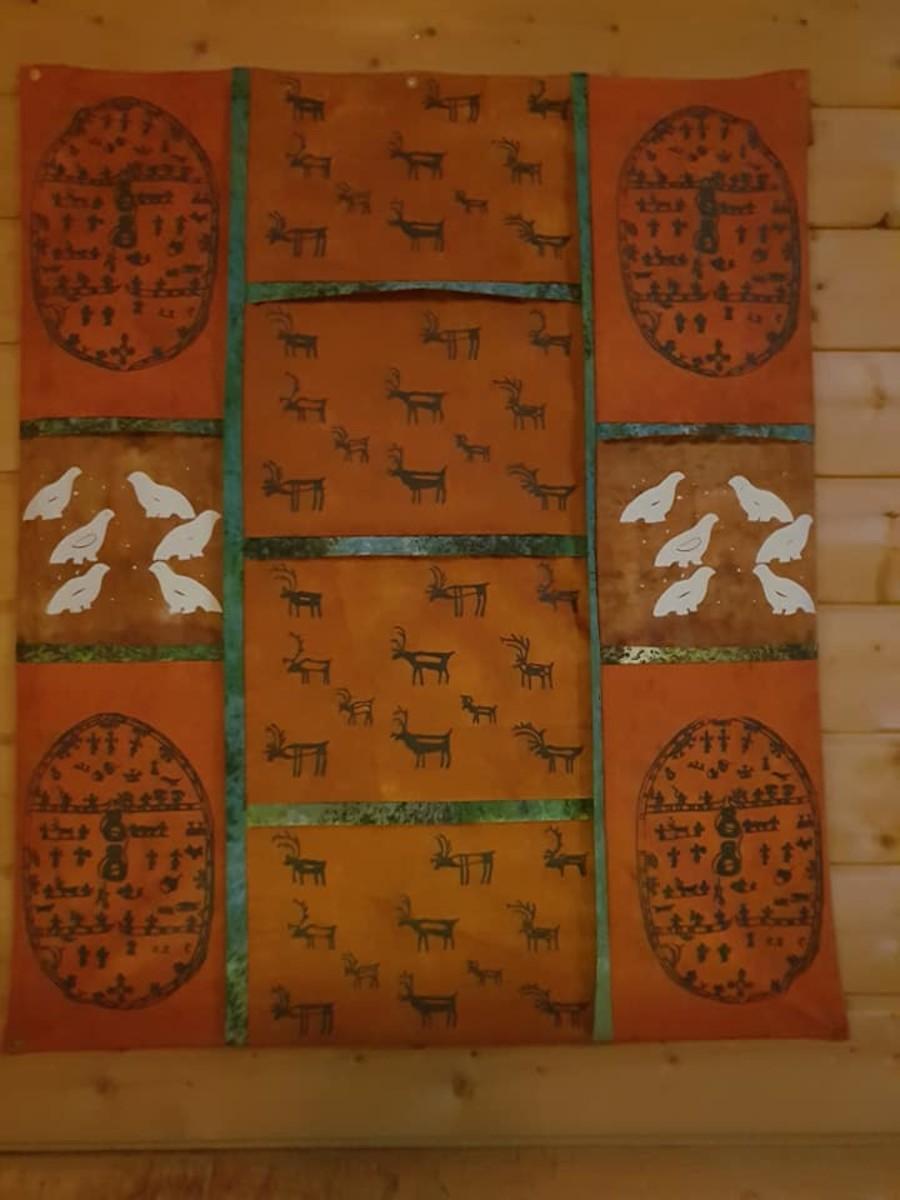 Wall art inside the koti shows depictions of noadi drum markings.