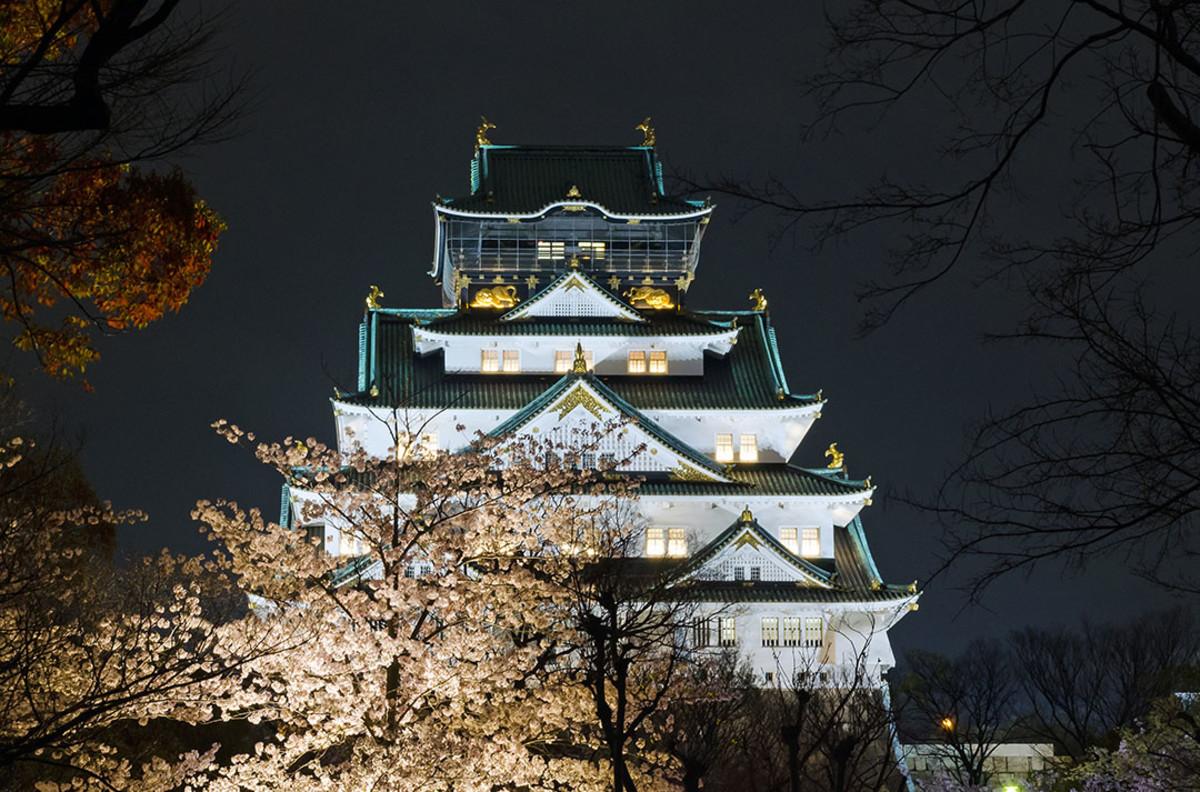 Nighttime Osaka Castle during Hanami i.e. Sakura-viewing season.
