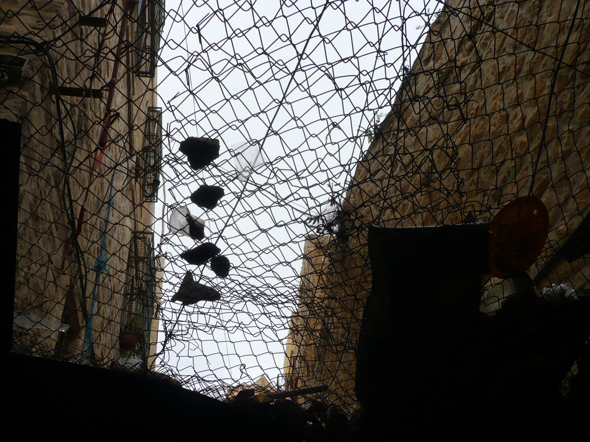 Stones, and  much worse, are thrown by settlers on to the traders in the souk.