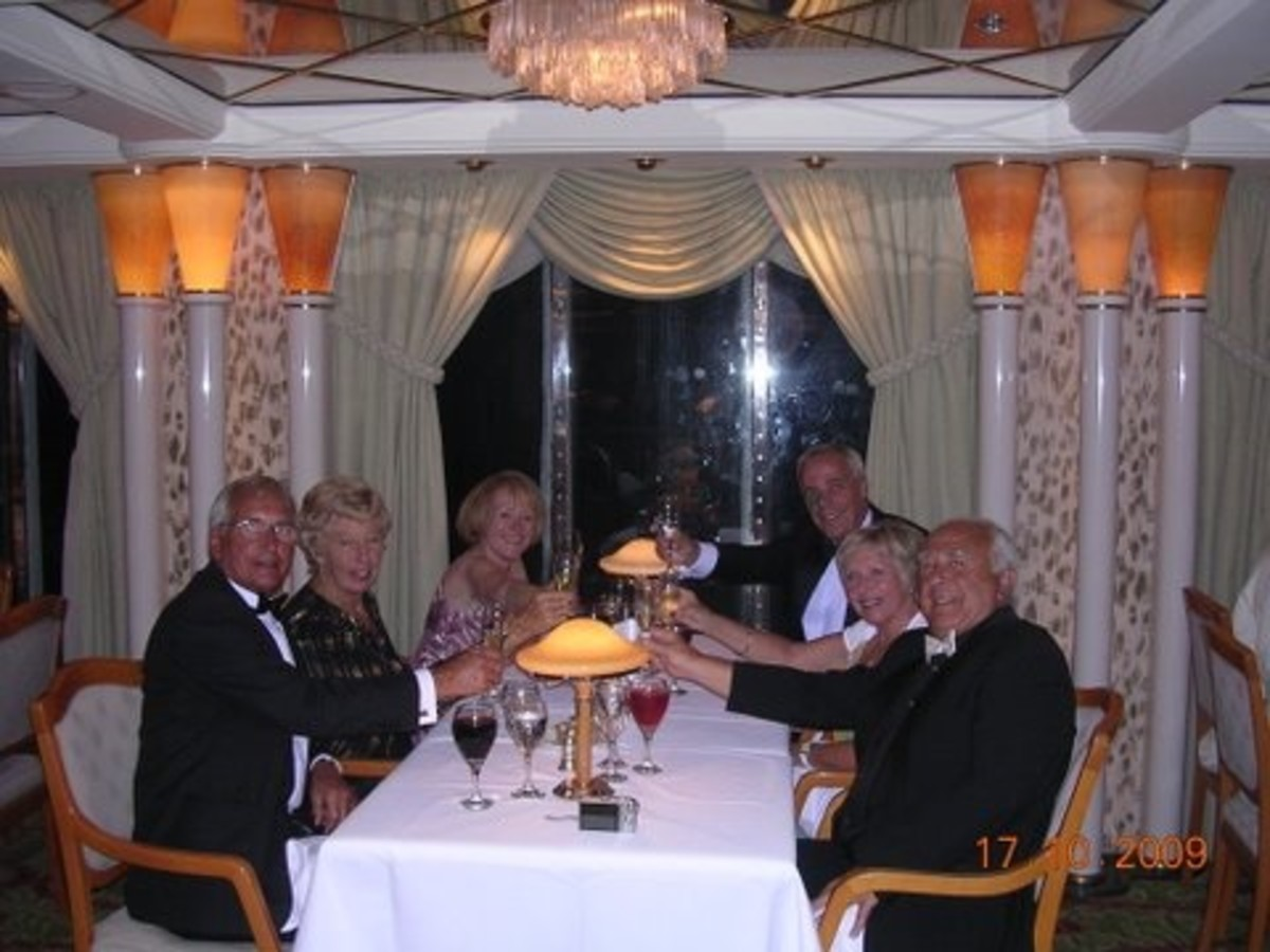 "Dining with our ""new friends"" on one of 3 or 4 formal nights on Oriana in 2009"