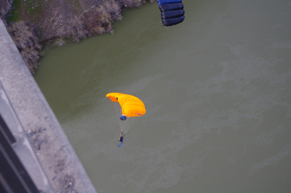 Base jumpers flying over the Snake River after jumping off of the Perrine Bridge in Twin Falls, Idaho.