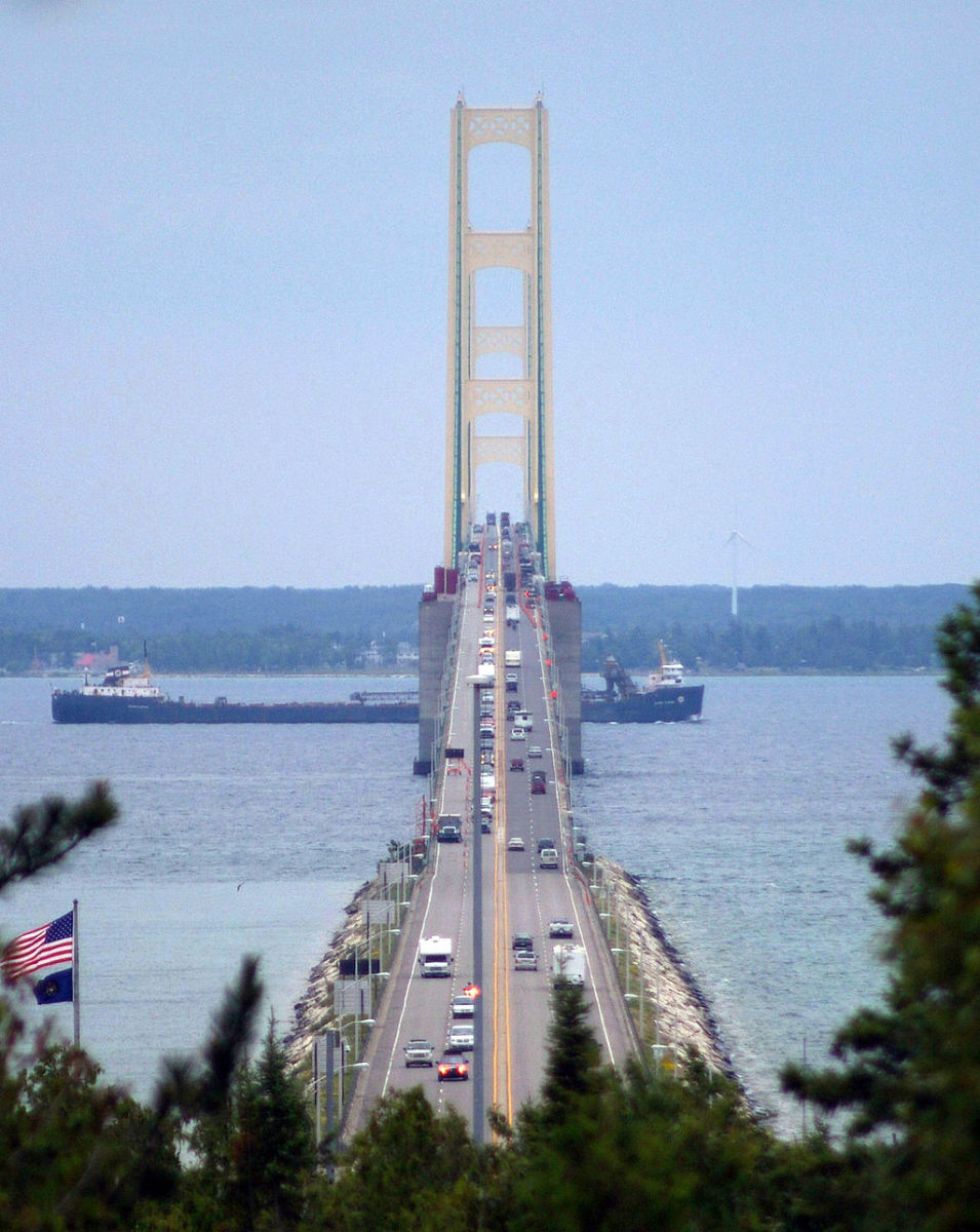 Freighter passing under the Mackinac Bridge as viewed from St. Ignace, Michigan.