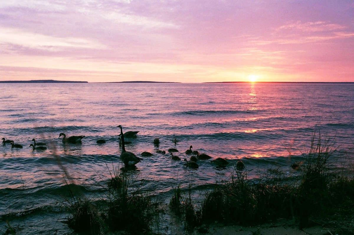 Sun rising over Lake Huron at Mackinaw City, Michigan