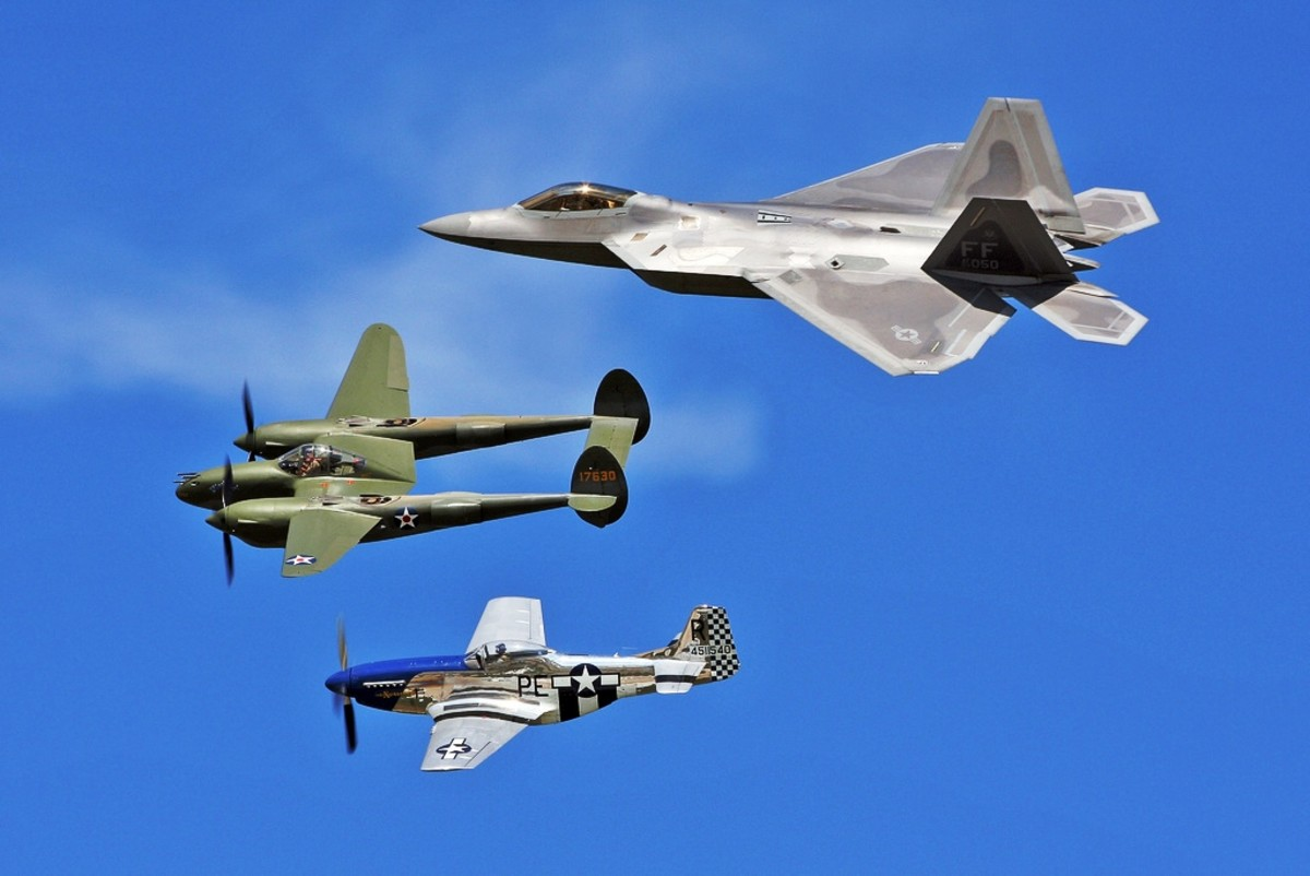 """USAF Heritage Flight (F-22A Raptor, P-38F Lightning """"Glacier Girl"""", and P-51D Mustang """"Excalibur"""")  at the EAA Museum in Oshkosh, Wisconsin"""