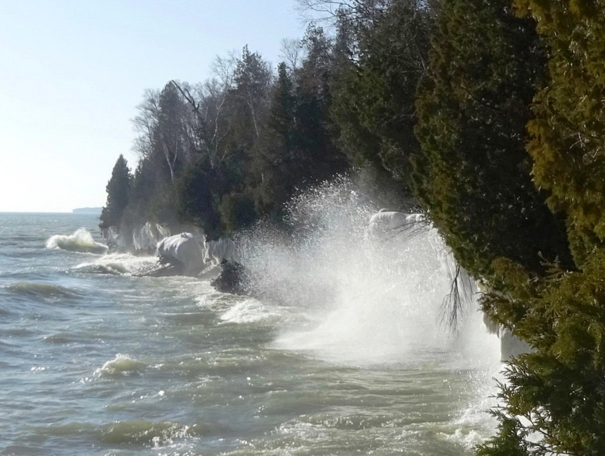 Waves crashing against the shore at Cave Point County Park in Door County, Wisconsin
