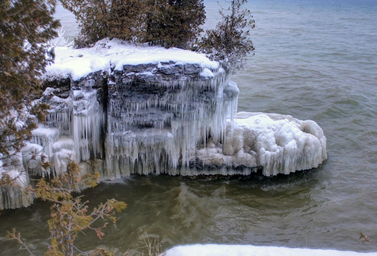 Winter ice on shore rocks at Whitefish Dunes State Park, Wisconsin - Door County