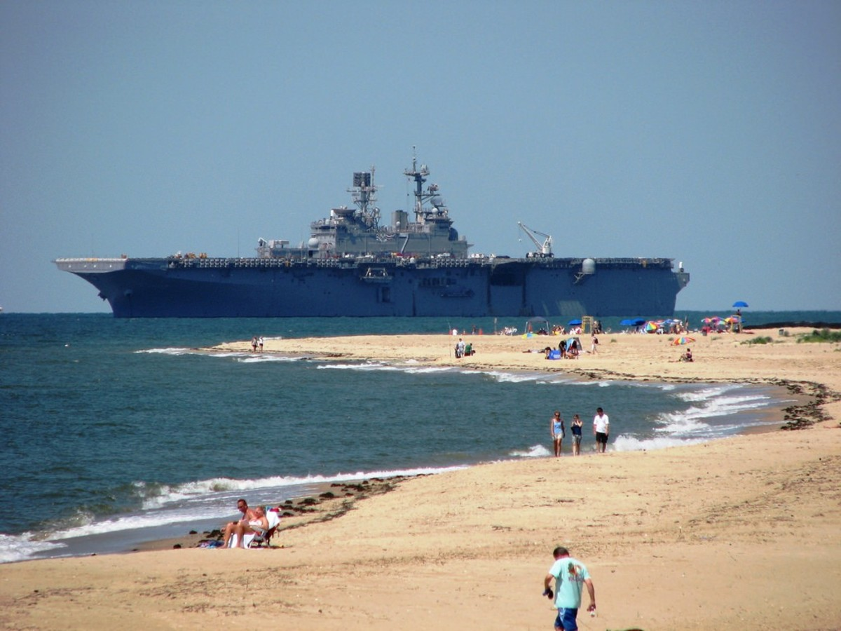 Aircraft Carrier entering Chesapeake Bay at First Landing State Park in Virginia Beach, Virginia.