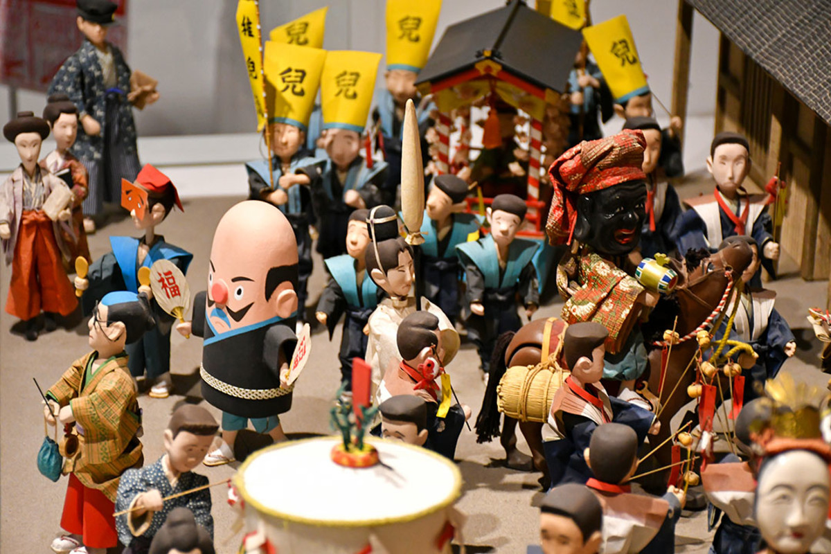 Matsuri revelers. Hakata Machiya Folk Museum is a delight for travelers into miniature photography.