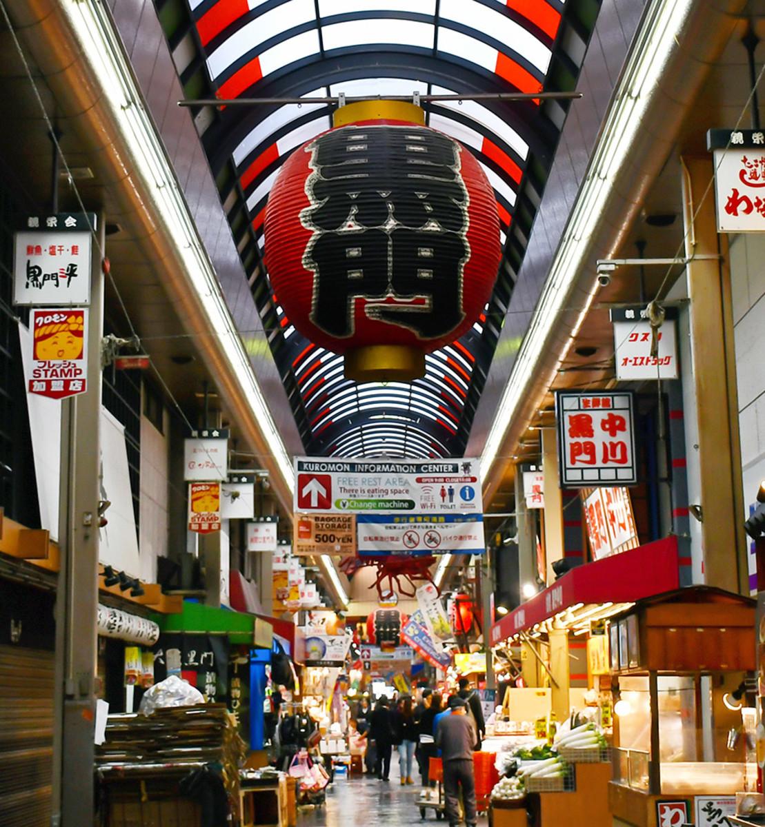 "The famous ""black gate"" lantern of Kuromon Food Market."