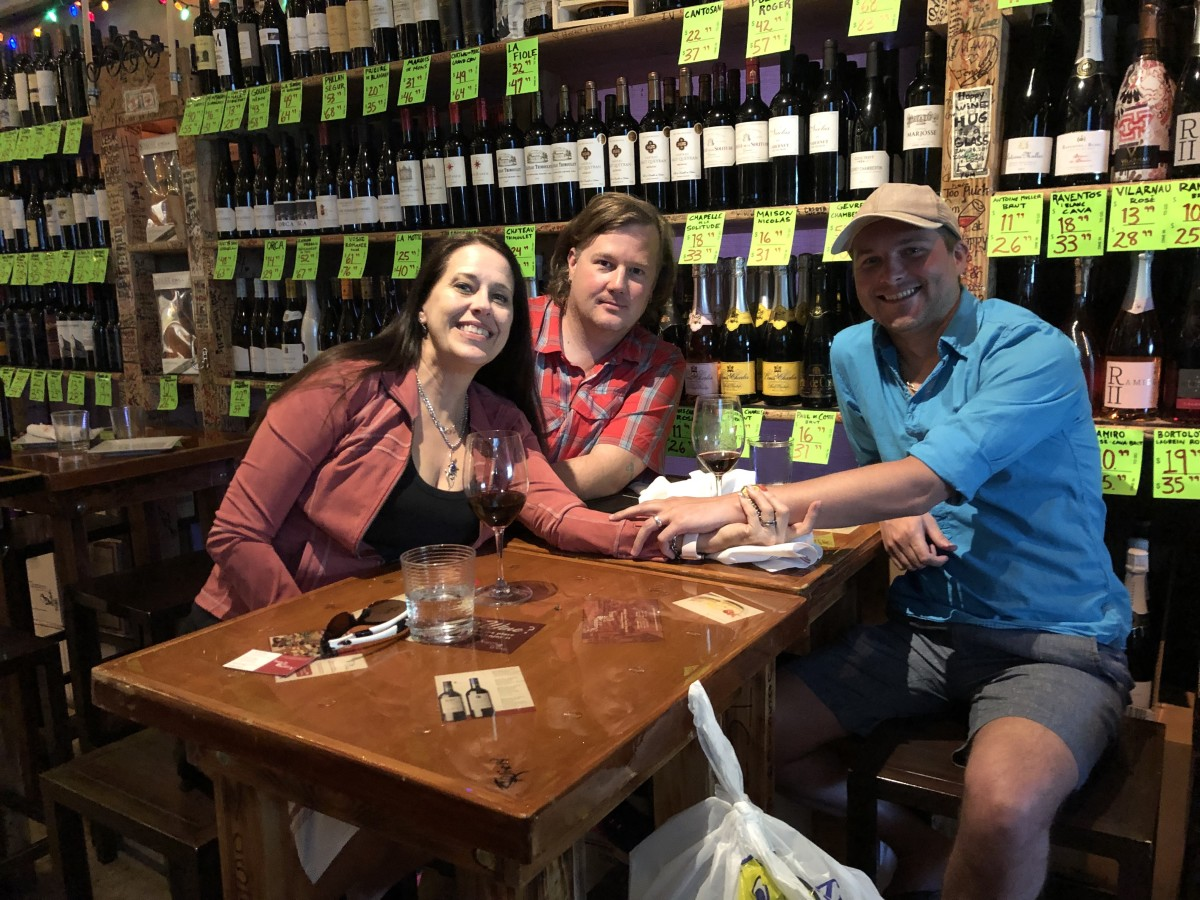 Feeling happy with my husband and nephew at Happy Wine the evening before our cruise!