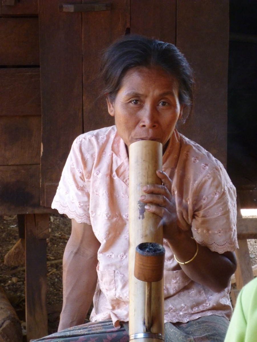Local village elder smoking large pipe.
