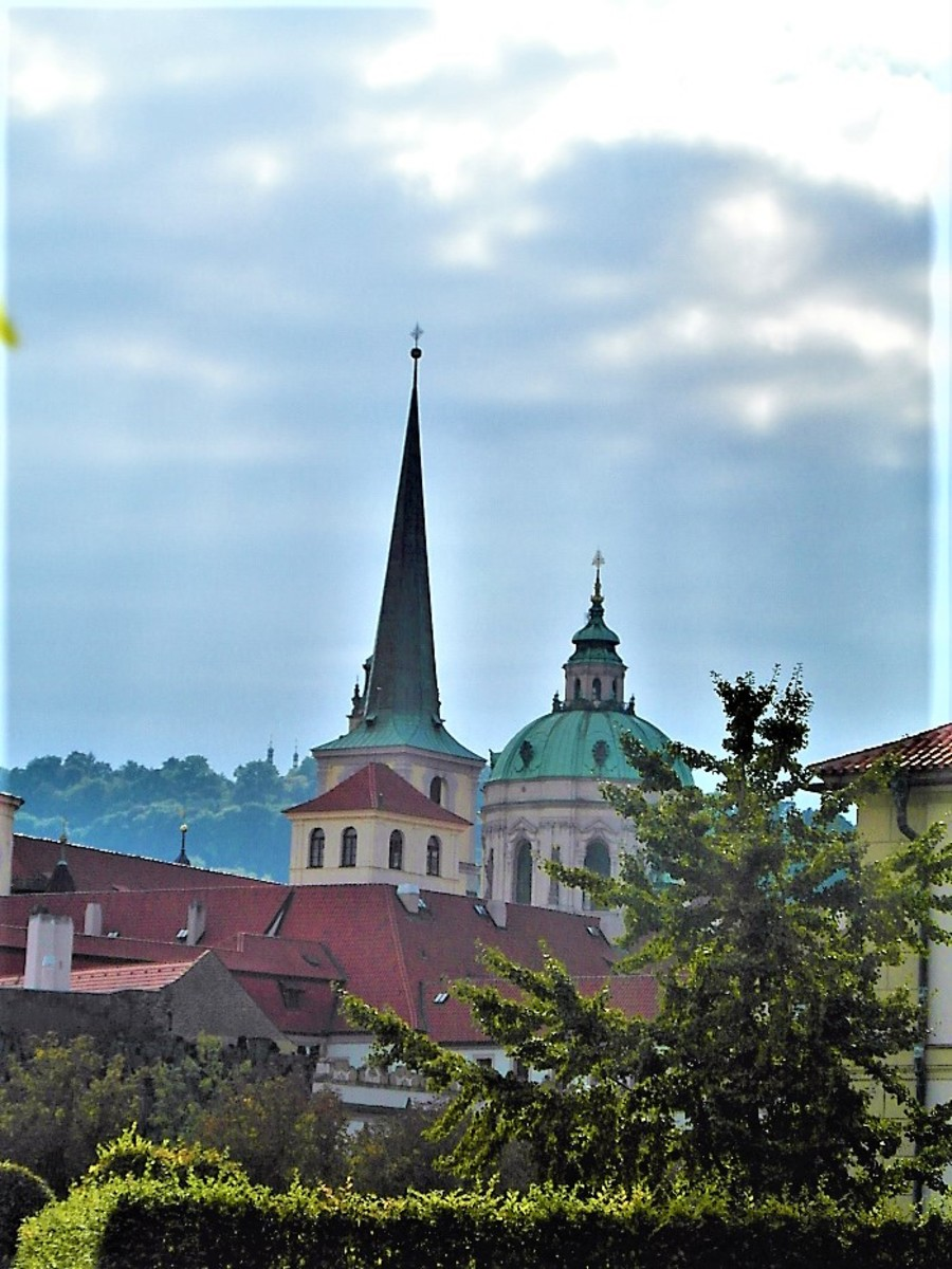 Mala Strana skyline from within the walls of Wallenstein Palace gardens.
