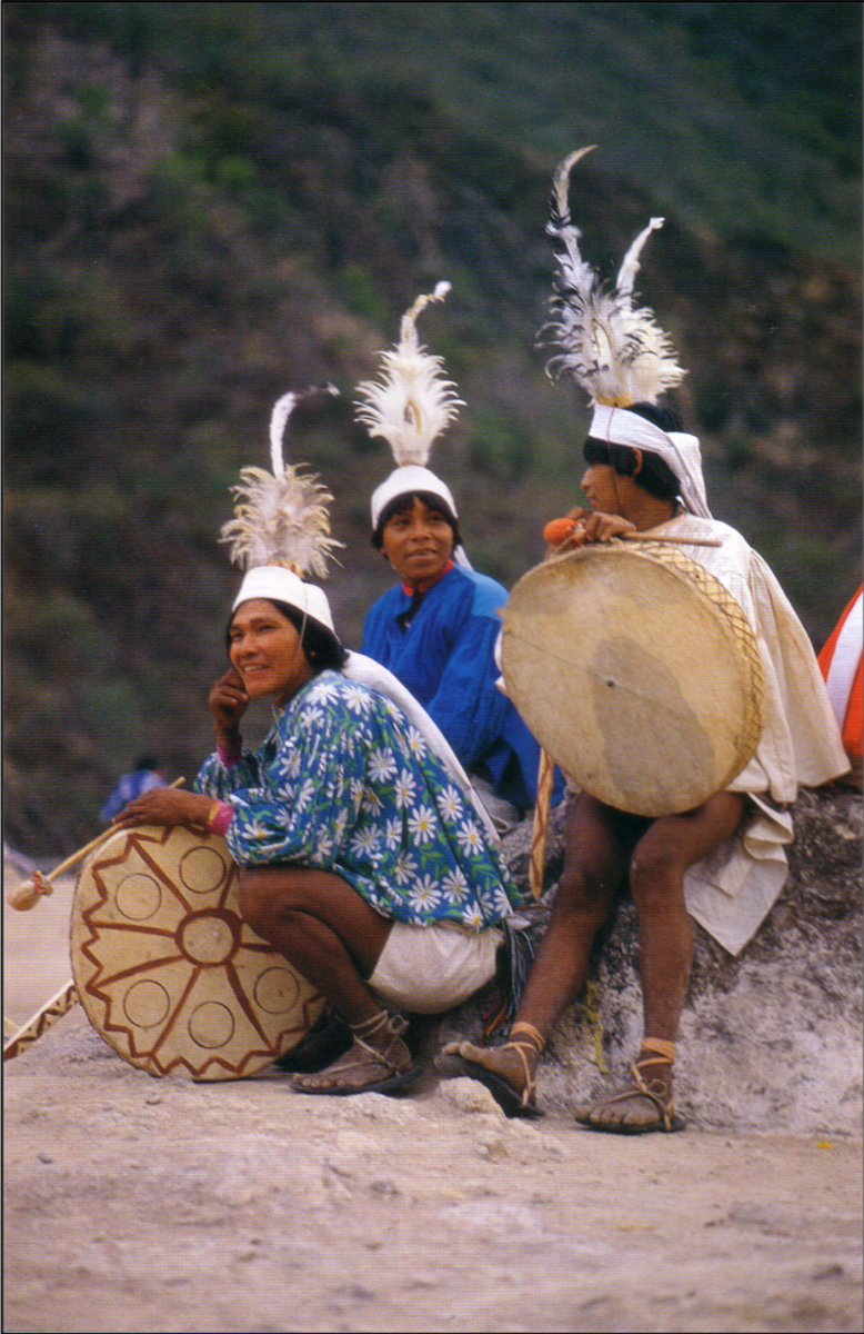 Several Tarahumara youths with their newly made drums await the start of the festivities.