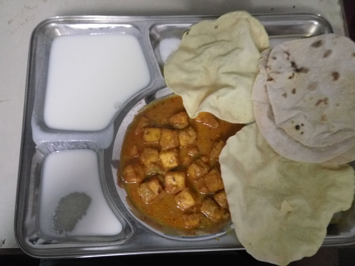 A typical lunch of Chapati, Paneer butter Masala and Dahi