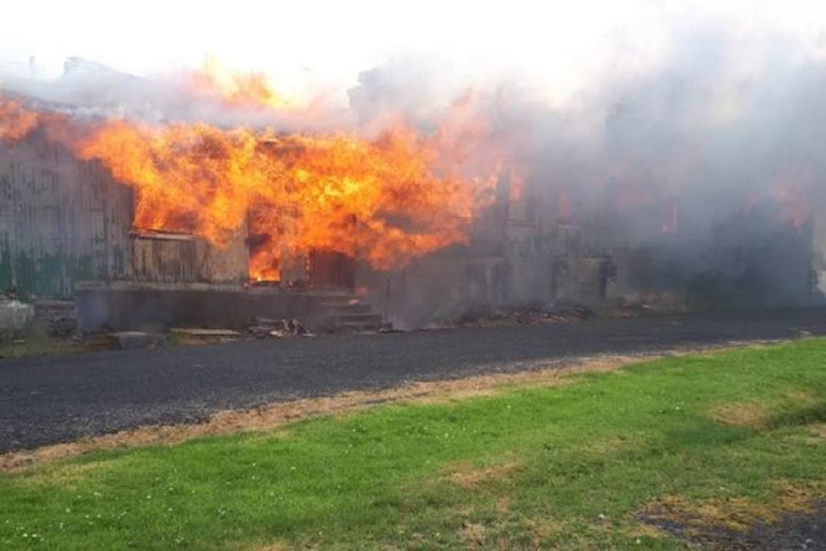 Fire engulfs the old barracks on 1 July 2019