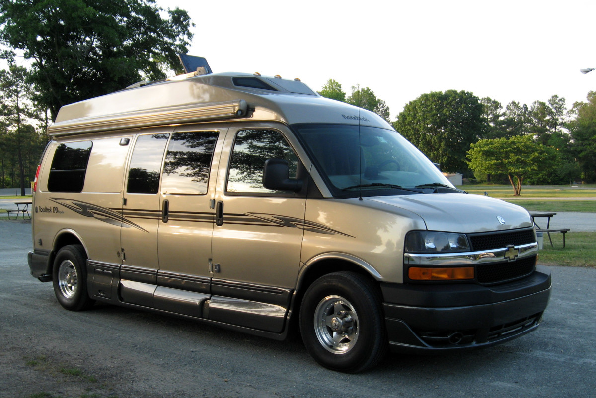 The RoadTrek, a compact but fully-outfitted  campervan with a bed, kitchen, bathroom, and more.