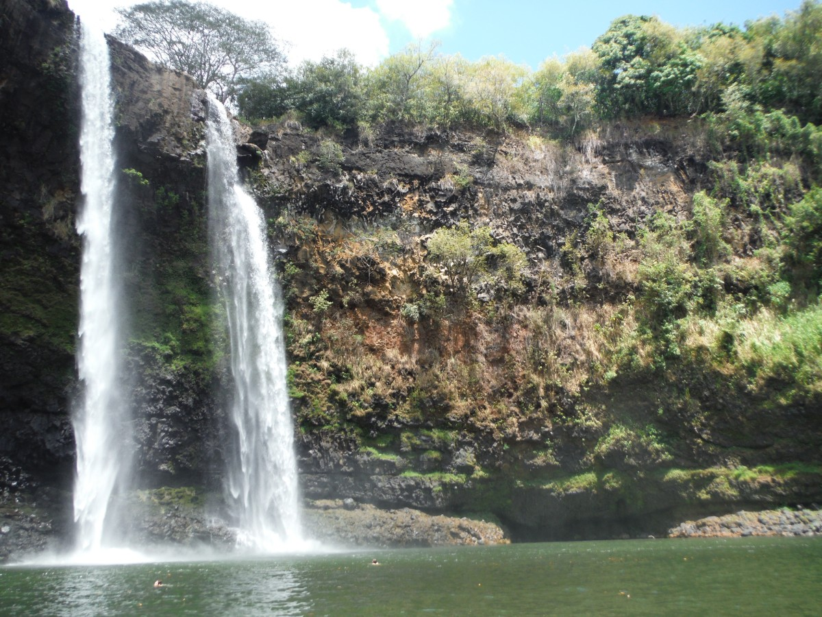 Venture to Wailua Falls on Kauai and feel the freedom of dipping your toes into the water and listening to the rushing waterfall.