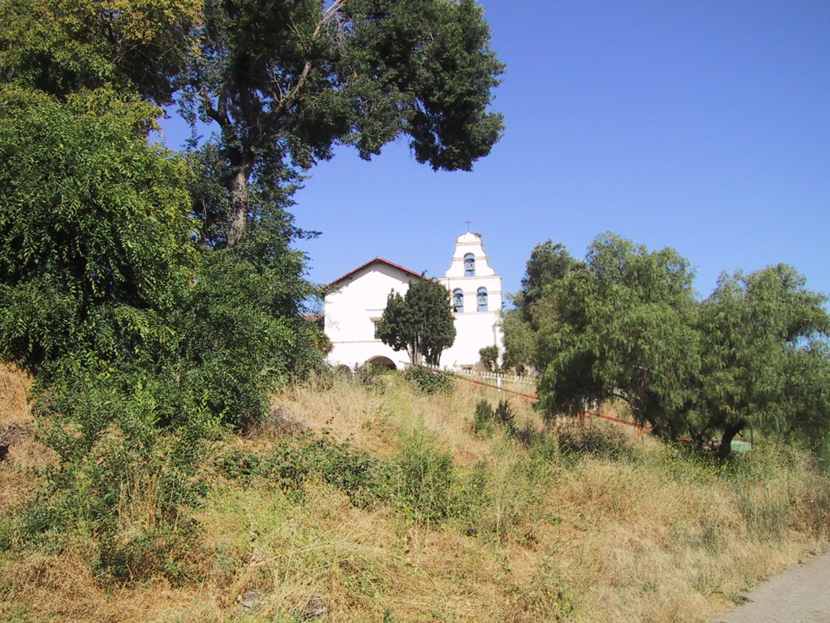 Mission San Juan Bautista church, viewed from the original mission trail.