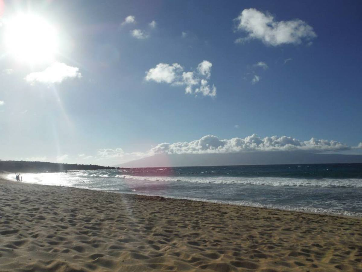 The long stretches of beach along Napili Bay offer a panoramic view for sunsets.