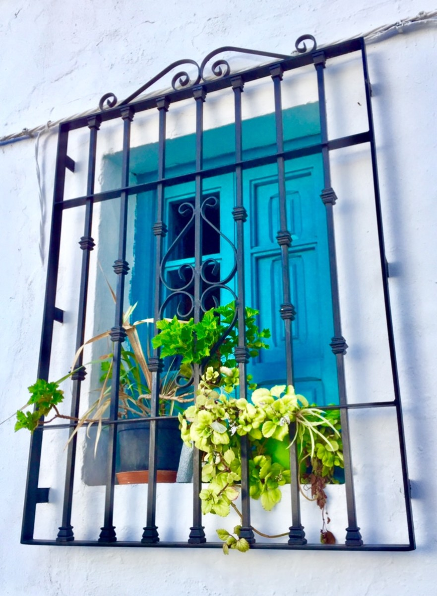 Beautiful turquoise window facing the street.