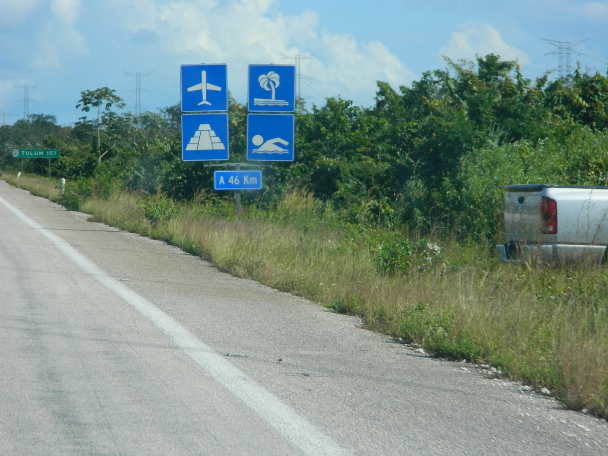 Roadsigns showing a pyramid indicate nearby Mayan sites.
